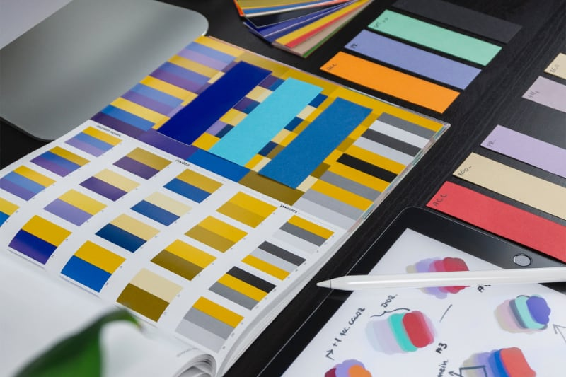 color palettes sketches and design tools on a desk